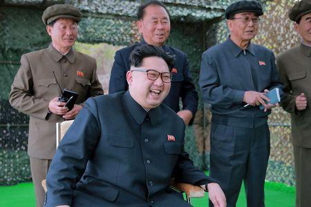 North Korean leader Kim Jong Un guides on the spot the underwater test-fire of strategic submarine ballistic missile in this undated photo released by North Korea's Korean Central News Agency (KCNA) in Pyongyang on April 24, 2016. KCNA/via REUTERS.