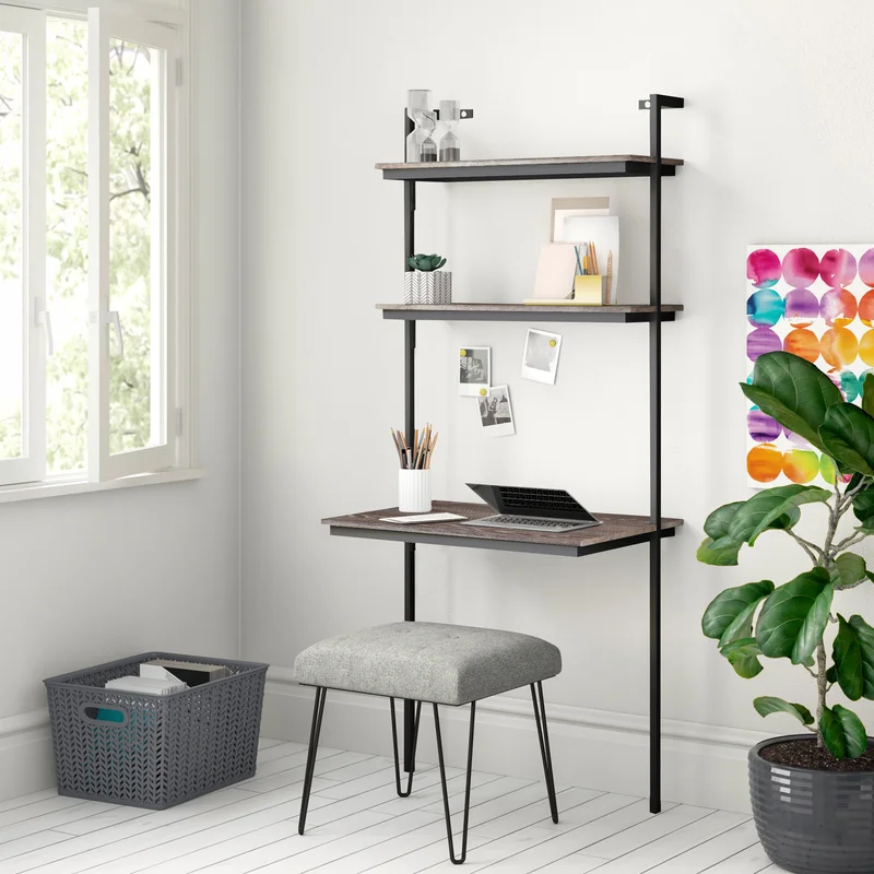 "<h3>Wayfair Arcade Leaning Ladder Desk<br></h3><br>Always fantasized about having a home office, but figured your small apartment rendered that idea impossible? Meet the compact ladder-bookshelf meets desktop workstation that's here to change that — with a streamlined wall-mountable wink. <br><br><strong>Zipcode Design</strong> Arcade Leaning/Ladder Desk, $, available at <a href=""https://go.skimresources.com/?id=30283X879131&url=https%3A%2F%2Fwww.wayfair.com%2Ffurniture%2Fpdp%2Fzipcode-design-arcade-leaningladder-desk-w001273289.html"" rel=""nofollow noopener"" target=""_blank"" data-ylk=""slk:Wayfair"" class=""link rapid-noclick-resp"">Wayfair</a>"