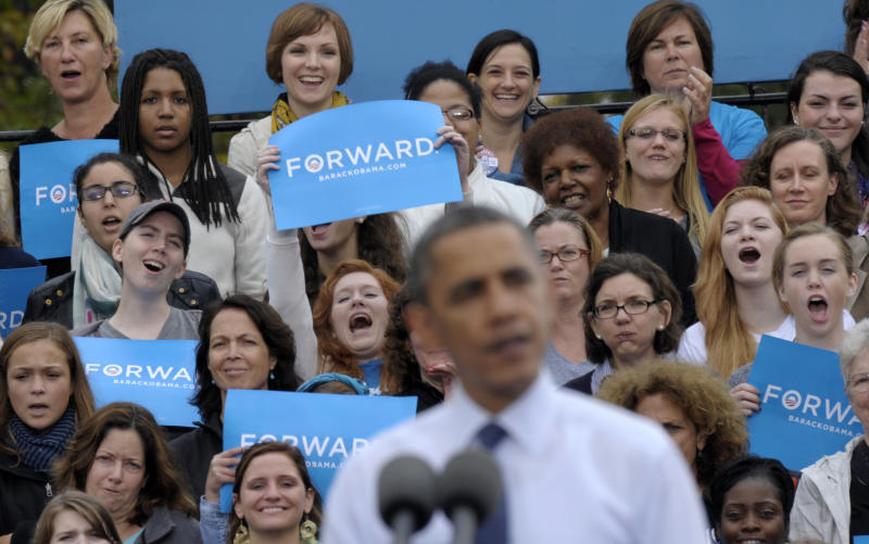 The audience behind President Barack Obama, who were mostly women, listen as Obama spoke about the choice facing women in the election during a campaign event at George Mason University in Fairfax, Va., Friday, Oct. 19, 2012. (AP Photo/Susan Walsh)