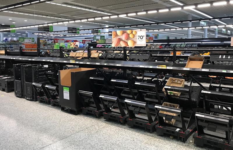 The empty fruit and vegetable section at an Asda store in Watford. (Reuters)