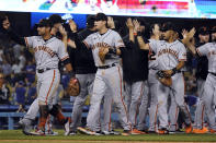 The San Francisco Giants celebrates a win over the Los Angeles Dodgers in a baseball game Wednesday, July 21, 2021, in Los Angeles. (AP Photo/Marcio Jose Sanchez)