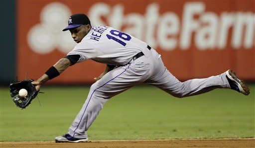 Colorado Rockies shortstop Jonathan Herrera stretches out to field a ground-out by Philadelphia Phillies' Chase Utley in the third inning of the second game of a baseball doubleheader, Sunday, Sept. 9, 2012, in Philadelphia. (AP Photo/Matt Slocum)