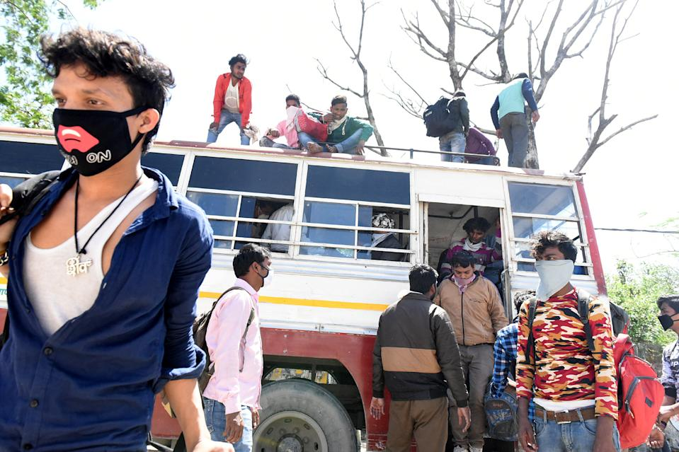 LUCKNOW, INDIA - MARCH 29: Migrant workers arrive at their native state on Day 5 of the 21 day nationwide lockdown imposed by PM Narendra Modi to curb the spread of coronavirus, at Asti Road, Bakshi Ka Talab, on March 29, 2020 in Lucknow, India. (Photo by Dheeraj Dhawan/Hindustan Times via Getty Images)