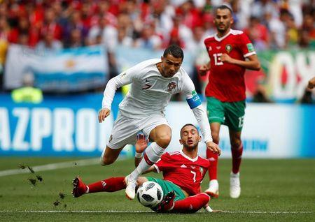 Soccer Football - World Cup - Group B - Portugal vs Morocco - Luzhniki Stadium, Moscow, Russia - June 20, 2018 Portugal's Cristiano Ronaldo in action with Morocco's Hakim Ziyech REUTERS/Axel Schmidt