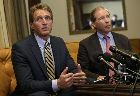 Flake speaks to reporters as Udall listens during a news conference in Havana