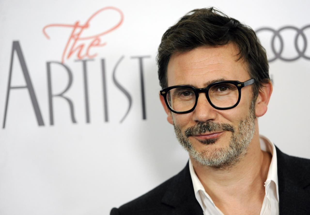 """FILE - In this Nov. 21, 2011 file photo, Michel Hazanavicius, writer/director of """"The Artist,"""" poses at a screening of the film in Beverly Hills, Calif. Hazanavicius was nominated Tuesday, Jan. 24, 2012 for an Academy Award for best director for the film. The Oscars will be presented Feb. 26 at the Kodak Theatre in Los Angeles, hosted by Billy Crystal and broadcast live on ABC. (AP Photo/Chris Pizzello, file)"""