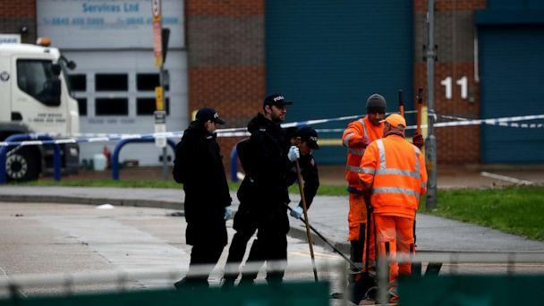 PHOTO: Police officers inspect a drain at the scene where bodies were discovered in a lorry container, in Grays, Essex, Britain October 24, 2019. (Simon Dawson/Reuters)