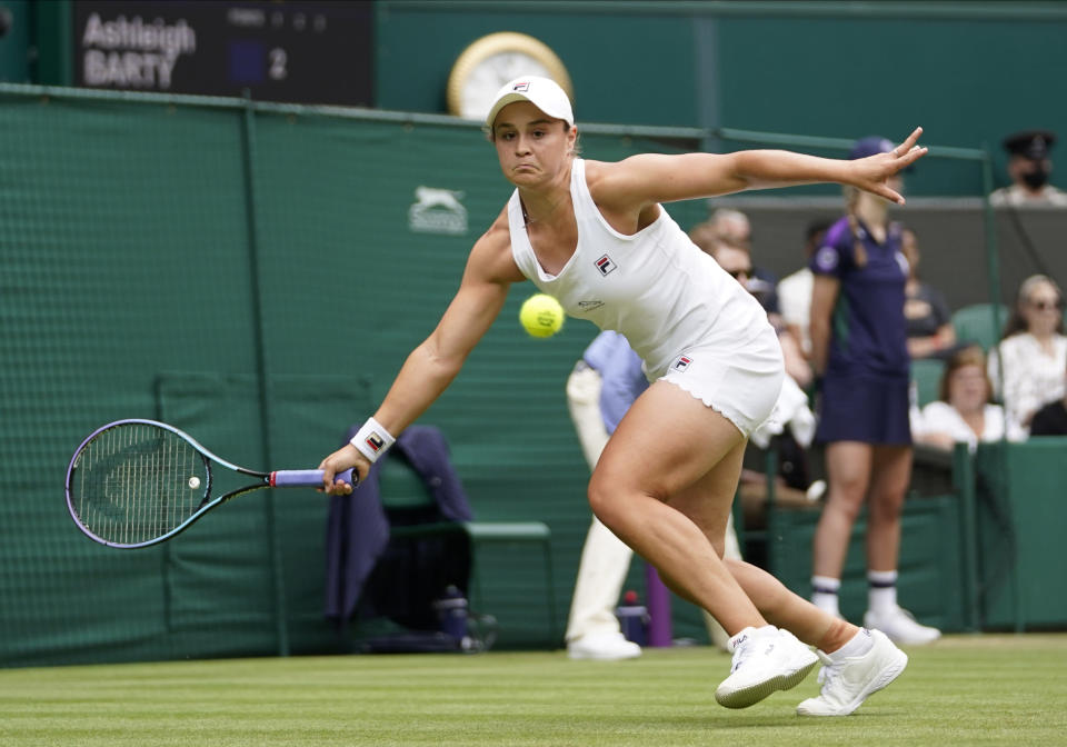 Australia's Ashleigh Barty plays a return to Russia's Anna Blinkova during the women's singles second round match on day four of the Wimbledon Tennis Championships in London, Thursday July 1, 2021. (AP Photo/Alberto Pezzali)