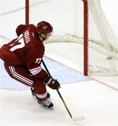 Phoenix Coyotes' Radim Vrbata scores on an empty net with one second left in the third period during an NHL hockey game against the San Jose Sharks on Saturday, Feb, 4, 2012 in Glendale, Ariz.(AP Photo/Darryl Webb)