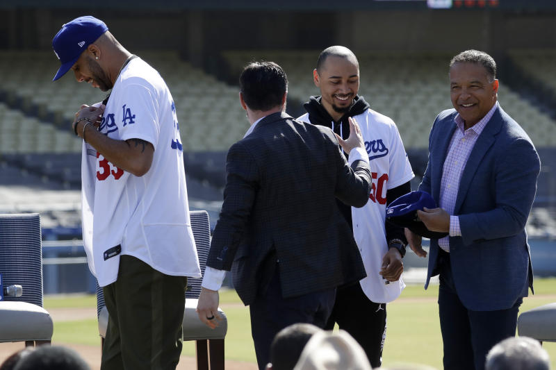 Dodgers begin spring training bolstered by addition of Betts