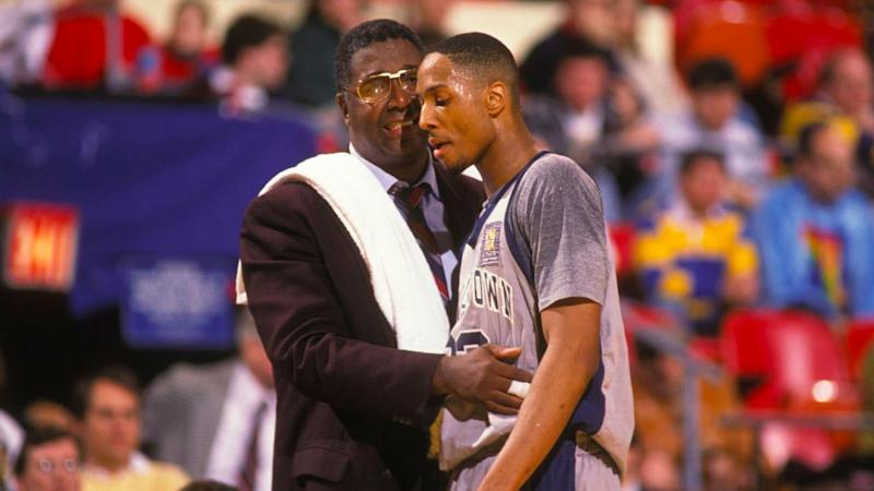 Thompson is pictured here with former Georgetown college star Alonzo Mourning.