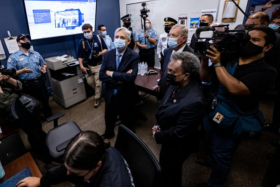 U.S. Attorney General Merrick Garland listens to a presentation alongside Sen. Dick Durbin (D-IL) and Chicago Mayor Lori Lightfoot while visiting the Chicago Police Department Strategic Decision Support Center on July 22, 2021 in Chicago, Illinois.