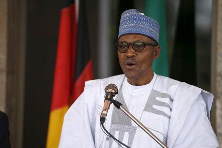 Nigerian President Muhammadu Buhari speaks during German President Joachim Gauck's visit to the State House in Abuja
