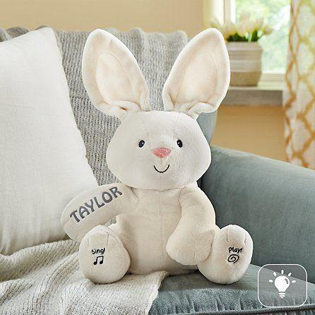 """<p><strong>Gund</strong></p><p>gifts.com</p><p><strong>$38.99</strong></p><p><a href=""""https://www.gifts.com/product/gund-peekaboo-bunny-30264370?viewpos=55&trackingpgroup=bbebsks"""" rel=""""nofollow noopener"""" target=""""_blank"""" data-ylk=""""slk:Shop Now"""" class=""""link rapid-noclick-resp"""">Shop Now</a></p><p>Fans of <a href=""""https://www.amazon.com/Gund-Animated-Flappy-Elephant-Plush/dp/B01AC7SF7K?tag=syn-yahoo-20&ascsubtag=%5Bartid%7C10050.g.26570259%5Bsrc%7Cyahoo-us"""" rel=""""nofollow noopener"""" target=""""_blank"""" data-ylk=""""slk:Flappy the Elephant"""" class=""""link rapid-noclick-resp"""">Flappy the Elephant</a> absolutely <em>must</em> have this personalized Easter bunny <a href=""""https://www.countryliving.com/shopping/gifts/g26570157/baby-easter-basket-ideas/"""" rel=""""nofollow noopener"""" target=""""_blank"""" data-ylk=""""slk:in their basket"""" class=""""link rapid-noclick-resp"""">in their basket</a>. As it sings and plays peek-a-boo, its ears move with the music and cover its eyes. Take our word for it: Your baby will be spellbound. </p>"""