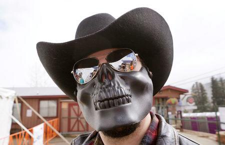 "A man poses in a skeleton mask at  the annual ""Frozen Dead Guy Days"" festival in Nederland"