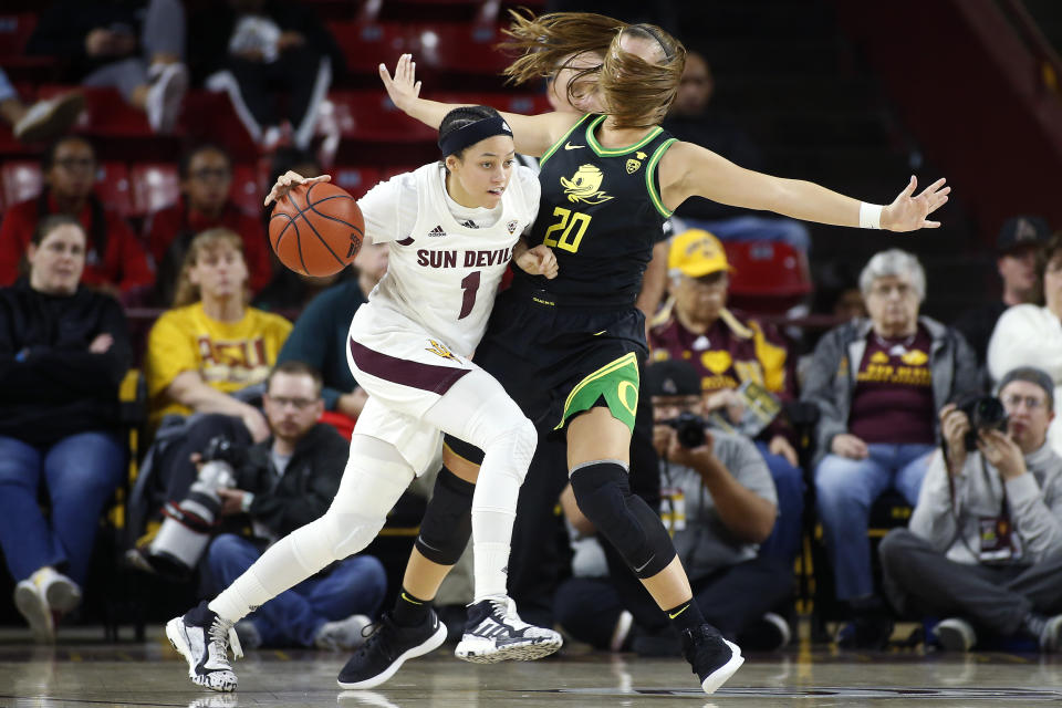 Arizona State guard Reili Richardson (1) collides with Oregon's Sabrina Ionescu (20) during the second half of an NCAA college basketball game Friday, Jan. 10, 2020, in Tempe, Ariz. Arizona State defeated No. 2 Oregon 72-66. (AP Photo/Ralph Freso)