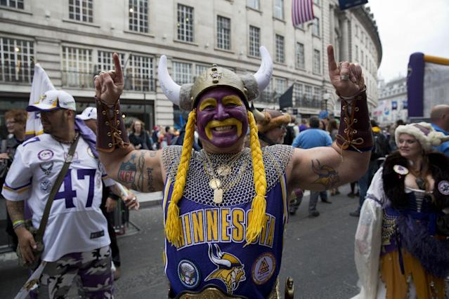 Minnesota Vikings fan Syd Davy from Winnipeg in Canada, poses for photographs during an NFL fan rally event in Regent Street, London, Saturday, Sept. 28, 2013. The Minnesota Vikings are to play the Pittsburgh Steelers at Wembley stadium in London on Sunday, Sept. 29 in a regular season NFL game. (AP Photo/Matt Dunham)