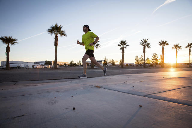 In this Jan. 31, 2019, photo provided by Jimmie Johnson Racing, NASCAR driver Jimmie Johnson runs in Las Vegas. The 83-time winner on the racetrack (sixth-most all-time), Johnson has long been a fitness freak who swam in high school and has run half marathons and triathlons. Johnson plans to run in the Boston Marathon on Monday, April 15, 2019. (Adam Moran/Jimmie Johnson Racing via AP)