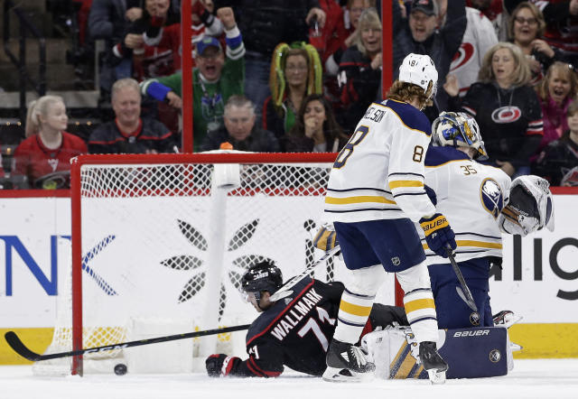 Carolina Hurricanes' Lucas Wallmark (71), of Sweden, scores against Buffalo Sabres goalie Linus Ullmark (35), of Sweden, during the first period of an NHL hockey game in Raleigh, N.C., Saturday, March 16, 2019. Sabres' Casey Nelson (8) looks on. (AP Photo/Gerry Broome)