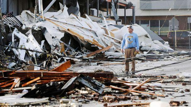 PHOTO: A man looks over buildings destroyed by storms, March 3, 2020, in Nashville, Tenn. (Mark Humphrey/AP)
