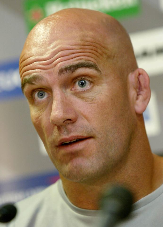 (FILES) New Zealand All Black coach John Mitchell speaks during a press conference in Melbourne, 11 November 2003. Former All Blacks coach John Mitchell was stabbed by intruders who broke into his apartment in South Africa, his club the Golden Lions said on October 11, 2010. Two men broke into a Johannesburg apartment Mitchell was sharing with fellow New Zealander Wayne Taylor on Saturday night and one of them stabbed the 46-year-old during a struggle, Lions spokeswoman Krystal Geach said. AFP PHOTO / WILLIAM WEST / FILES(FILES) New Zealand All Black coach John Mitchell speaks during a press conference in Melbourne, 11 November 2003. Former All Blacks coach John Mitchell was stabbed by intruders who broke into his apartment in South Africa, his club the Golden Lions said on October 11, 2010. Two men broke into a Johannesburg apartment Mitchell was sharing with fellow New Zealander Wayne Taylor on Saturday night and one of them stabbed the 46-year-old during a struggle, Lions spokeswoman Krystal Geach said. AFP PHOTO / WILLIAM WEST / FILES (AFP Photo/WILLIAM WEST)