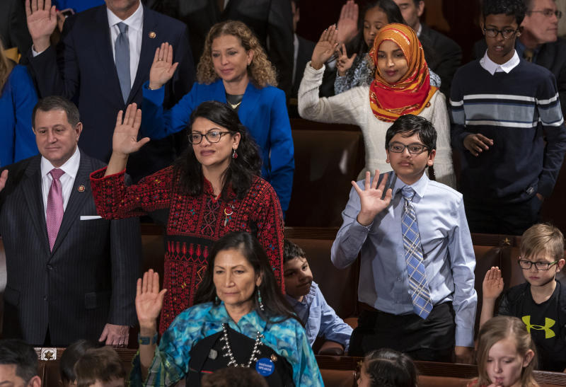 FILE - In this Jan. 3, 2019 file photo, Rep. Rashida Tlaib, D-Mich., center left, wears a Palestinian thobe as Democratic members of the House of Representatives take their oath on the opening day of the 116th Congress, at the Capitol in Washington. Tlaib proudly wore her thobe to her historic swearing-in as the first Palestinian American member of Congress, inspiring women around the world to tweet photos of themselves in their ancestral robes. (AP Photo/J. Scott Applewhite, File)