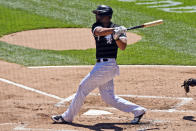 Chicago White Sox's Jose Abreu (79) hits an RBI single during the first inning in the first baseball game of a doubleheader against the Baltimore Orioles, Saturday, May 29, 2021, in Chicago. (AP Photo/Matt Marton)