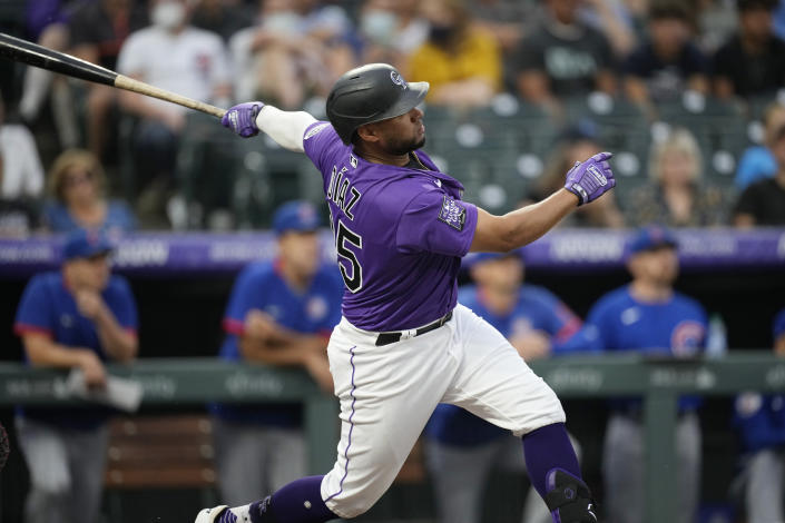 Colorado Rockies' Elias Diaz follows the flight of his grand slam off Chicago Cubs starting pitcher Zach Davies in the second inning of a baseball game Tuesday, Aug. 3, 2021, in Denver. (AP Photo/David Zalubowski)