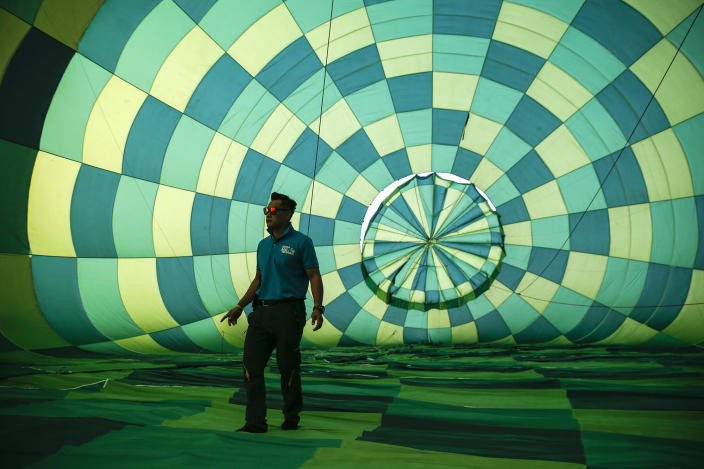 <p>A staff member inspects the interior of a hot air balloon during the 2016 International Hot Air Balloon Festival in Taitung, southeast of Taiwan, July 1, 2016. (Photo: EPA/RITCHIE B. TONGO) </p>