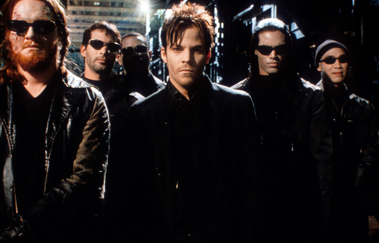 Stephen Dorff amongst men wearing sunglasses in a scene from the film 'Blade', 1999. (Photo by Amen Ra Films/Getty Images)