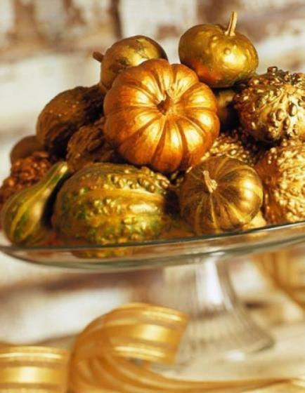 """<div class=""""caption-credit""""> Photo by: StyleCaster</div>For this centerpiece all you need is a variety of miniature pumpkins or gourds and some gold spray paint. Stack them on a glass cake plate or on their own and voilà! You have an elegant autumn display. <br> Image Via Better Homes and Gardens"""