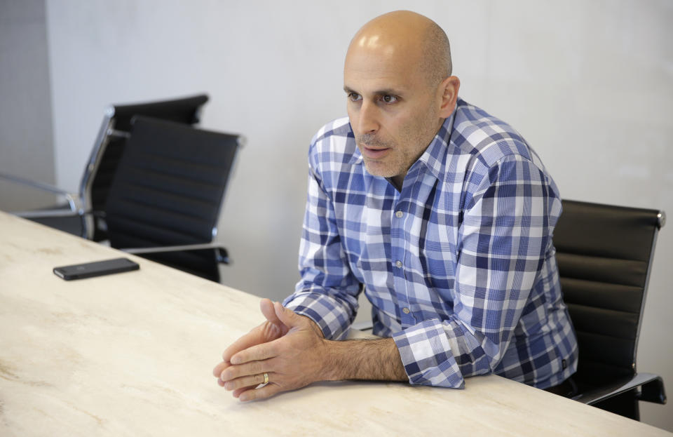 In this Monday, May 2, 2016, photo, Jet.com CEO Marc Lore talks to a reporter in Hoboken, N.J. Lore aims to reinvent the shopping cart while taking on Amazon.com. The marketplace site, launched in July 2015 to a lot of scrutiny, now sells more than 11 million products ranging from jeans to diapers in its bid to underprice an industry Goliath and other stores. (AP Photo/Seth Wenig)