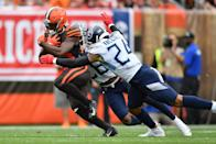 Dontrell Hilliard #25 of the Cleveland Browns protects the ball as he is pursued by Logan Ryan #26 of the Tennessee Titans and Kenny Vaccaro #24 of the Tennessee Titans in the second quarter at FirstEnergy Stadium on September 08, 2019 in Cleveland, Ohio . (Photo by Jamie Sabau/Getty Images)