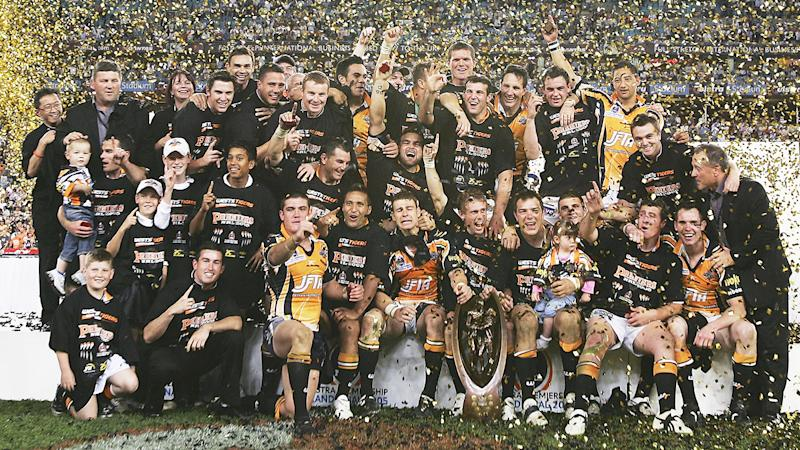 The Wests Tigers celebrate victory after the 2005 NRL Grand Final. (Photo by Adam Pretty/Getty Images)