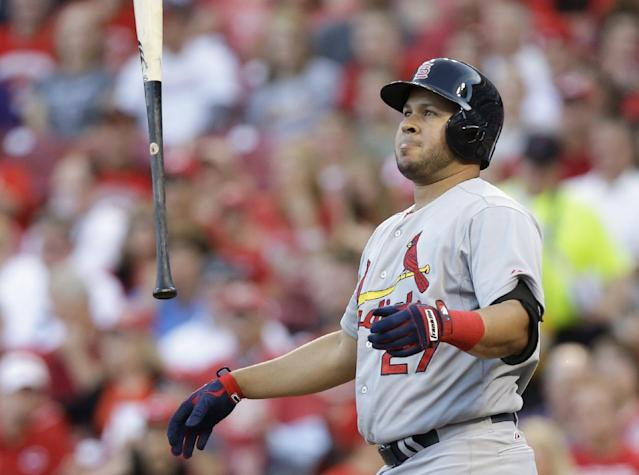 St. Louis Cardinals' Jhonny Peralta reacts after striking out against Cincinnati Reds starting pitcher Homer Bailey in the fourth inning of a baseball game, Friday, May 23, 2014, in Cincinnati. (AP Photo/Al Behrman)