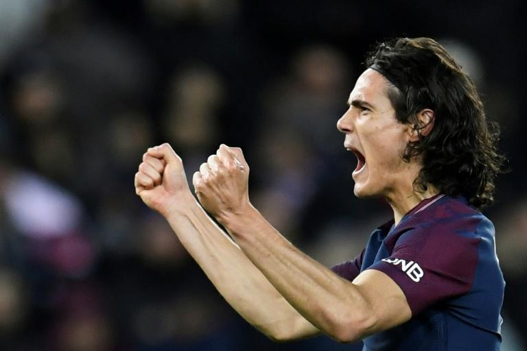 Paris Saint-Germain's forward Edinson Cavani celebrates after scoring his team's third goal, to equal the club's top scorer, during the French L1 football match between Paris Saint-German and Dijon in Paris