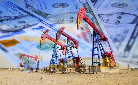 Oil pumps with money in the background.