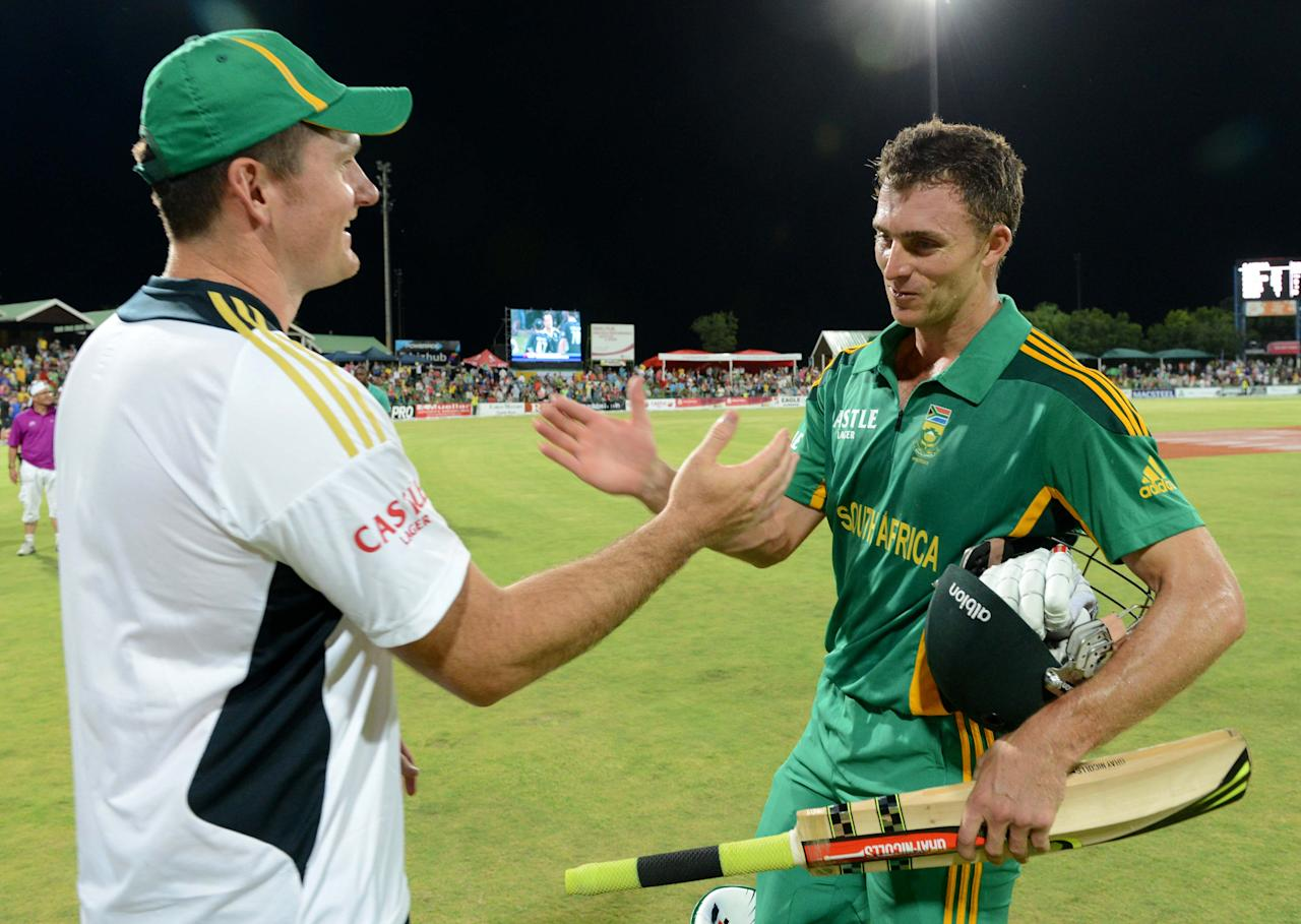 POTCHEFSTROOM, SOUTH AFRICA - JANUARY 25:  Graeme Smith of South Africa celebrates with Ryan McLaren during the 3rd One Day International match between South Africa and New Zealand at Senwes Park on January 25, 2013 in Potchefstroom, South Africa. (Photo by Lee Warren/Gallo Images/Getty Images)