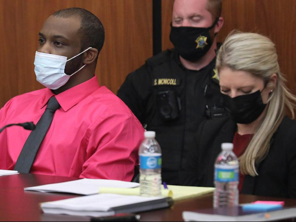 Defendant Nathaniel Rowland sits with his attorney Alicia Goode during closing arguments in his trial on Tuesday 27 July 2021 (AP)