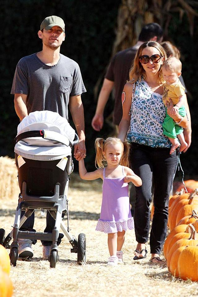 """Tobey Maguire and wife Jennifer Meyer take their children, 2-year-old Ruby and 5-month-old Otis, to help pick out the perfect pumpkin. Jennifer and Ruby both wore their hearts (painted) on their sleeves as they strolled around Mr. Bones. Max Butterworth/Bret Thompsett/Louise Barnsley/<a href=""""http://www.pacificcoastnews.com/"""" target=""""new"""">PacificCoastNews.com</a> - October 24, 2009"""