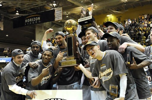 Valparaiso players hold the championship trophy after a 62-54 win in a NCAA college basketball game with Wright State for the Horizon League Championship Tuesday March 12, 2013 in Valparaiso, Ind. (AP Photo/Joe Raymond)