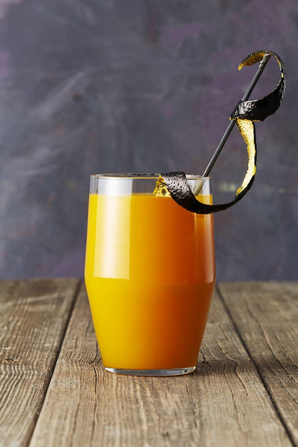 "<p>Garnish this party potion the Halloween way by painting orange peel strips with black gel food coloring. </p><p><em><a href=""https://www.goodhousekeeping.com/food-recipes/a46066/apricot-bourbon-brew-recipe/"" rel=""nofollow noopener"" target=""_blank"" data-ylk=""slk:Get the recipe for Apricot Bourbon Brew »"" class=""link rapid-noclick-resp"">Get the recipe for Apricot Bourbon Brew »</a></em><br></p>"