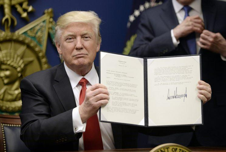 "Trump signs executive orders calling for the ""extreme vetting"" of visa seekers from terror-plagued countries on Friday. (Olivier Douliery-Pool/Getty Images)"