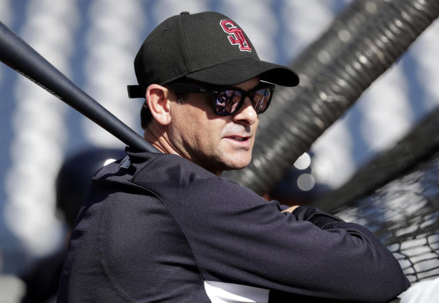 New York Yankees manager Aaron Boone wears a hat honoring the victims of the shooting at Marjory Stoneman Douglas High School as he watches batting practice before a spring training baseball game against the Detroit Tigers, Friday, Feb. 23, 2018, in Tampa, Fla. (AP Photo/Lynne Sladky)