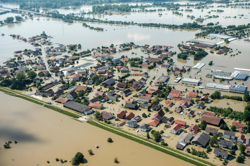 Aerial view of a part of Deggendorf which was flooded by the river Danube due to a broken dam in southern Germany, Wednesday, June 5, 2013, Heavy rainfalls caused floods in Germany, Austria, Switzerland, the Czech Republic and Hungary. (AP Photo/dpa, Armin Weigel)