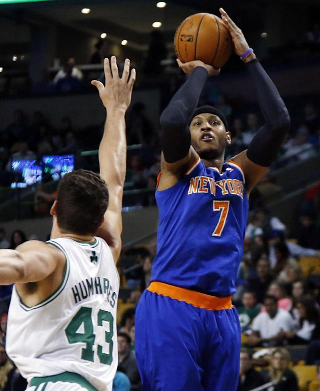 New York Knicks forward Carmelo Anthony (7) shoots against Boston Celtics center Kris Humphries (43) during the first quarter of an NBA basketball game in Boston, Wednesday, March 12, 2014. (AP Photo/Elise Amendola)