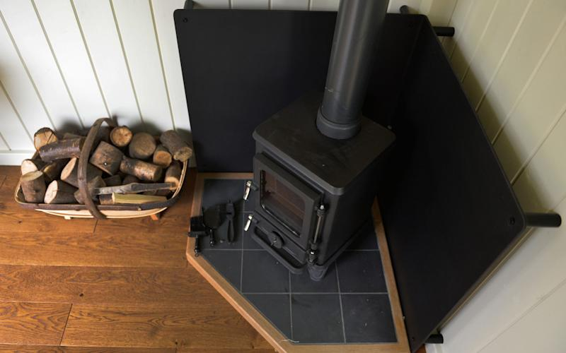 A 'Hobbit' wood-burning stove - Credit: Graham Flack/Red Sky Shepherds/PA