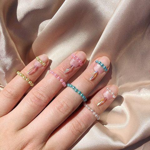 "<p>Take your accessorising to the next level with pearl and crystal nail embellishment and matching knuckle rings.</p><p><a href=""https://www.instagram.com/p/CAKgvZ_jMAi/?utm_source=ig_embed&utm_campaign=loading"" rel=""nofollow noopener"" target=""_blank"" data-ylk=""slk:See the original post on Instagram"" class=""link rapid-noclick-resp"">See the original post on Instagram</a></p>"