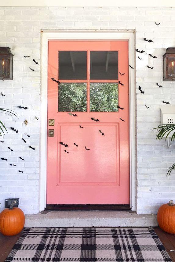 """<p>Leave the life-size skeletons and creepy-crawly décor to the neighbors. This year, opt for a simplistic look instead with the help of some easy-to-apply bat decals.</p><p><strong>Get the tutorial at <a href=""""http://looklingerlove.com/blog/decor/halloween-front-door/"""" rel=""""nofollow noopener"""" target=""""_blank"""" data-ylk=""""slk:Look Linger Love"""" class=""""link rapid-noclick-resp"""">Look Linger Love</a>.</strong></p><p><a class=""""link rapid-noclick-resp"""" href=""""https://go.redirectingat.com?id=74968X1596630&url=https%3A%2F%2Fwww.walmart.com%2Fsearch%2F%3Fquery%3Dbat%2Bdecals&sref=https%3A%2F%2Fwww.thepioneerwoman.com%2Fholidays-celebrations%2Fg32894423%2Foutdoor-halloween-decorations%2F"""" rel=""""nofollow noopener"""" target=""""_blank"""" data-ylk=""""slk:SHOP BAT DECALS"""">SHOP BAT DECALS</a></p>"""