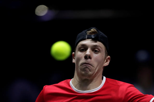 Canada's Denis Shapovalov eyes the ball during his tennis singles match of the Davis Cup final with Spain's Rafael Nadal in Madrid, Spain, Sunday, Nov. 24, 2019. (AP Photo/Manu Fernandez)